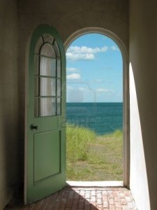 2722495-arched-doorway-opening-onto-a-grassy-beach-with-sunlight-streaming-in